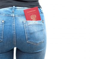 Passport in the pocket of jeans girl
